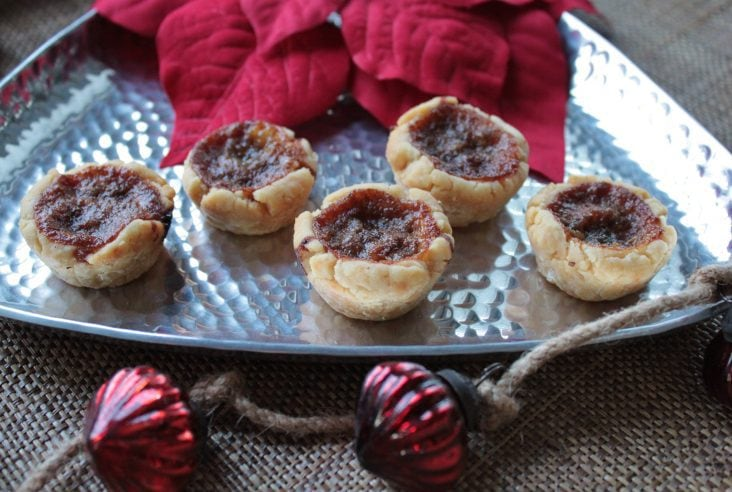 In our family, Christmas-time means buttertarts. We don't fool around with fiddly little currants either...it's raisins or pecans for us! Make these Mini Buttertarts for your family this Holiday season. #buttertarts #Christmas #treats #dessert