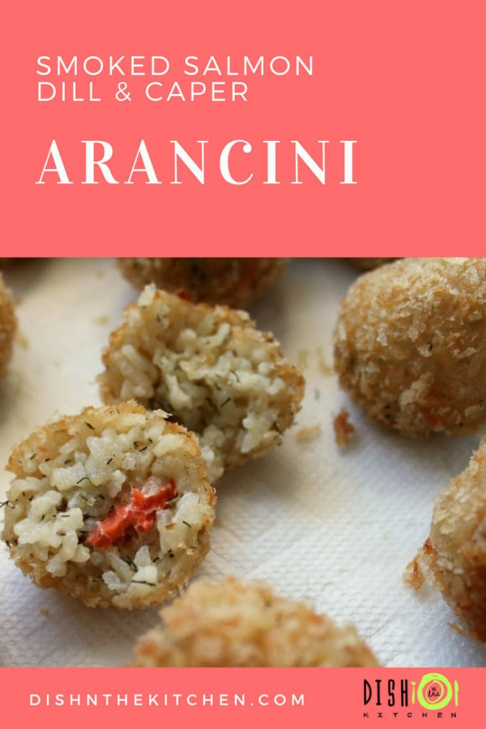 Pinterest image of Smoked Salmon Arancini showing insides filled with salmon, capers, and dill.