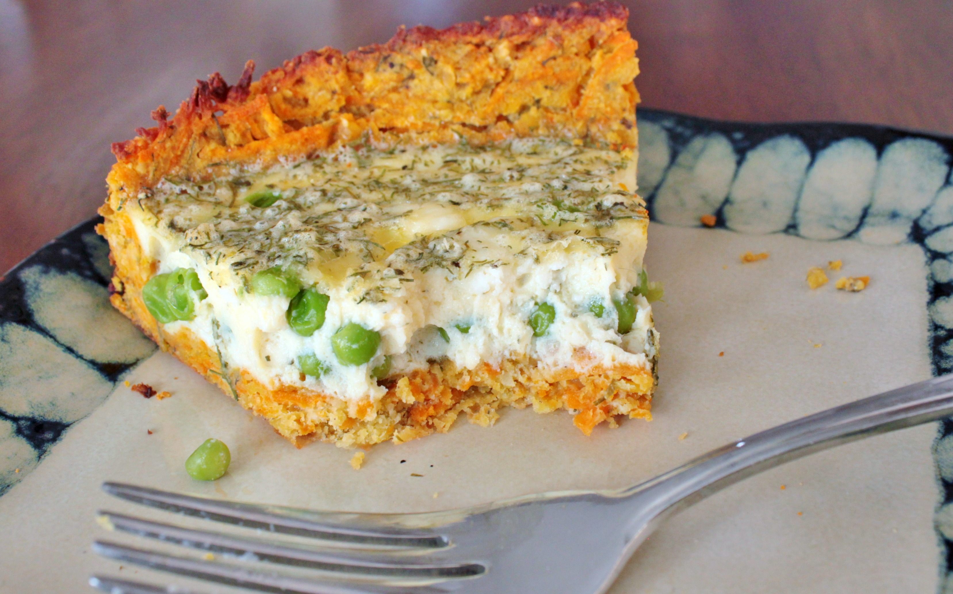 A delicious dill, pea, and feta quiche wrapped in a gluten free pastry made with red lentils, almonds, and grated sweet potato. #quiche #glutenfree #redlentilpastry