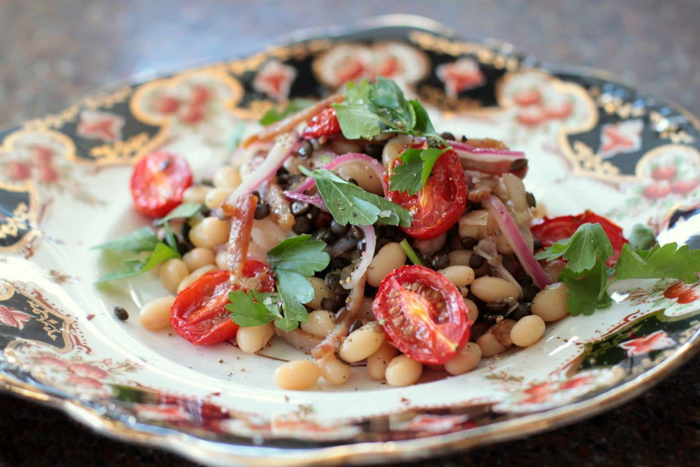 This warm bean bacon salad has a surprise ingredient....lentils! Lentils are packed with power nutrients and good for your soul. Add a hint of acidity with the oven roasted tomatoes and some freshness with the parsley. Voila! #lentilsalad #legumes #salad #pulses #warmsalad