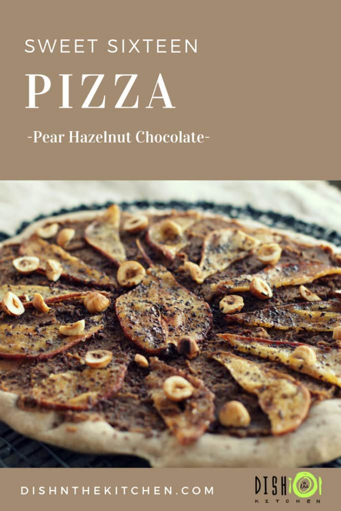 A sweetly styled and delicious sweet pizza with a chestnut flour crust and topped with candied pear, roasted hazelnuts,, and chocolate. #sweetpizza #dessertpizza #dessert #pizza