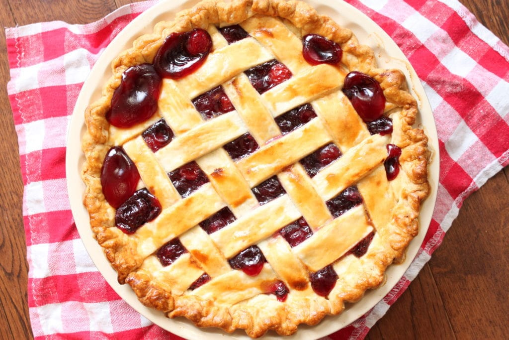 Amaretto Cherry Pie is a baked up boozy concoction of sweet Evans and sour Bing Cherries with the Almond flavours of Amaretto. #cherrypie #pie #cookingwithbooze