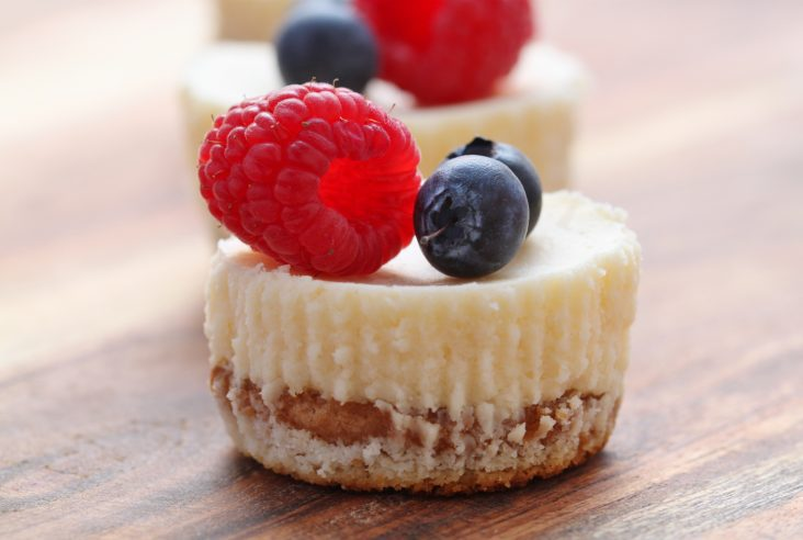 Perfectly sized, perfectly sweet, perfectly decadent Bite Sized Cheesecakes are the perfect after dinner dessert. #dinnerparty #Christmas #cheesecake #berrycheesecake #dessert