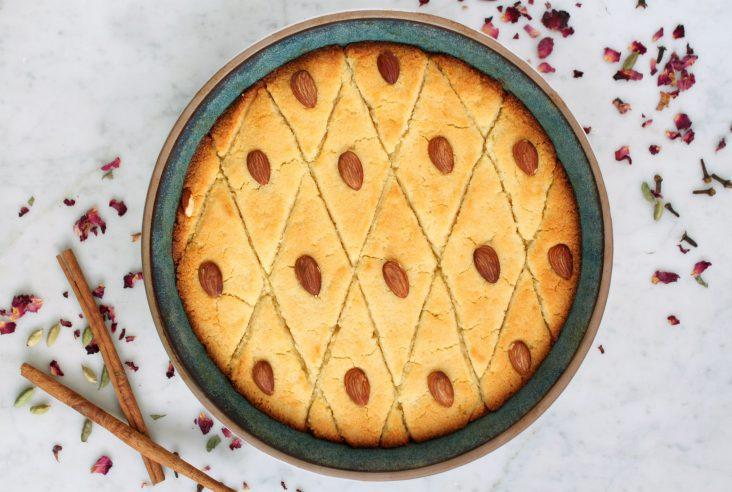 Egyptian Basbousa is a delicious tradtional Egyptian baked sweet cake made with coarse semolina and flavoured with honey. #basbousa #EgyptianCake #SemolinaCake #cake