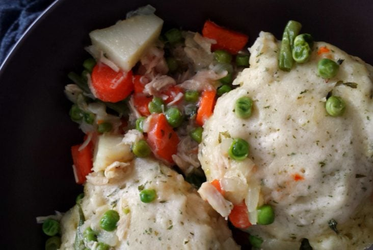 A bowl of comforting chicken with cloudlike dumplings