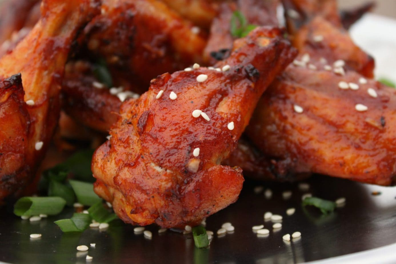 These Maple Gochujang Wings here to improve your day, your weekend, and yes...your superbowl party. Sweet and Spicy with just the right amount of sticky, they are super addictive. Betcha can't just eat one! #wings #chickenwings #gochujang #maplesyrup