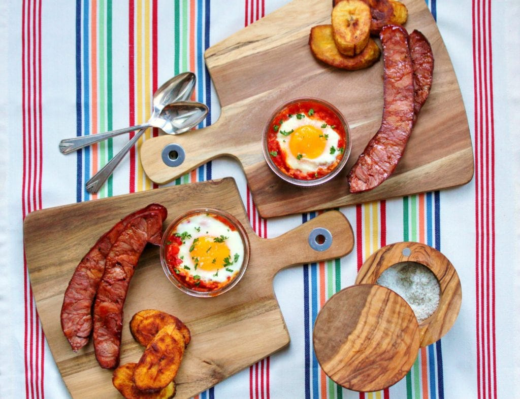 Start your day with Huevos Habaneros...A Cuban style breakfast of eggs coddled in spicy tomato sauce, grilled chorizo, and fried plantains. #Cuban #Breakfast #eggs