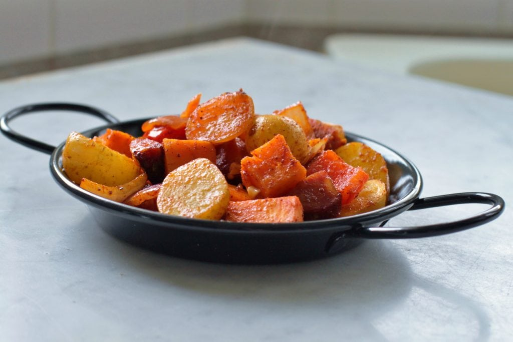 The perfect one pan family dinner for those crazy weeknights featuring Little Potatoes, Sweet Potatoes, and Spicy Paprika. An easy one pan dinner everyone will love! #onepan #chorizohash #dinner