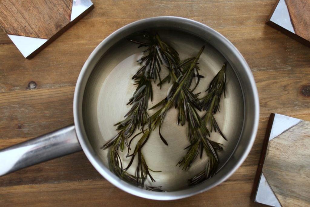 A pot of steeping rosemary