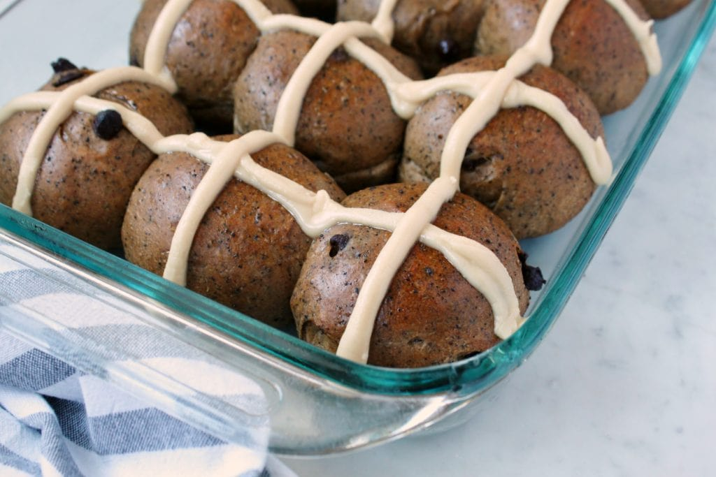 Mocha and Chocolate Chip Sourdough Hot Cross Buns - A glass baking dish full of hot cross buns.