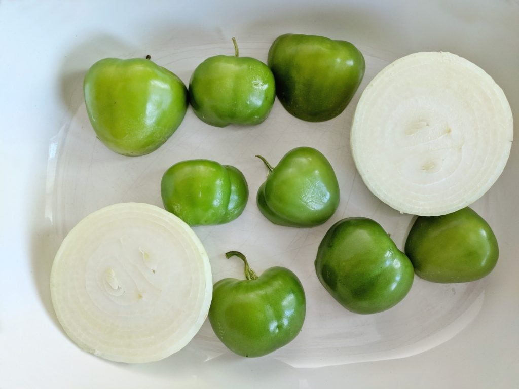 A platter of tomatillos and onions