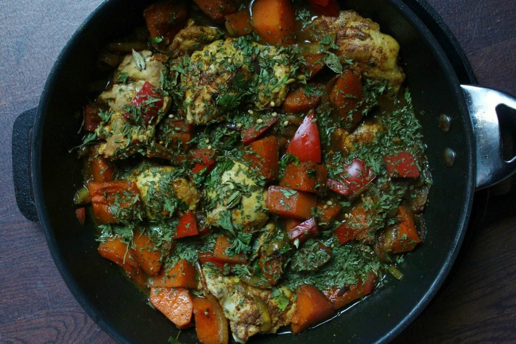 This Butternut Squash Chicken Tagine is made with a warming spice mixture called ras el hanout. Use an authentic traditional North African tajine or your regular method of braising. #tajine #onepan #chickentajine #butternutsquashchickentajine