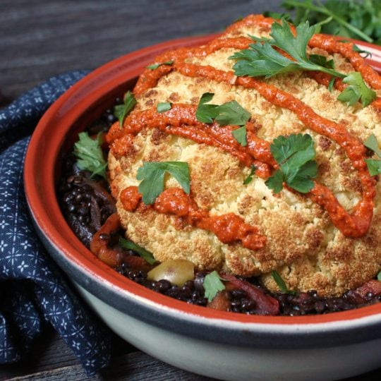 Tajine Lentil Stew makes a delicious vegan main with or without the roasted cauliflower. This smoky and hearty braise can be made in an authentic tajine or in a Dutch oven. #tajine #lentils #roasted cauliflower #veganmain #vegandinner #plantbased