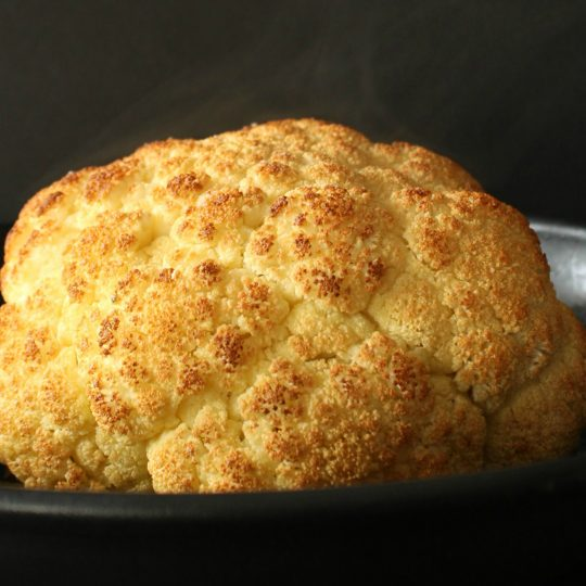 A Perfectly Whole Roasted Cauliflower is a wonderful thing and it's easier than you think. Here's how! #cauliflower #roastedcauliflower #wholecauliflower