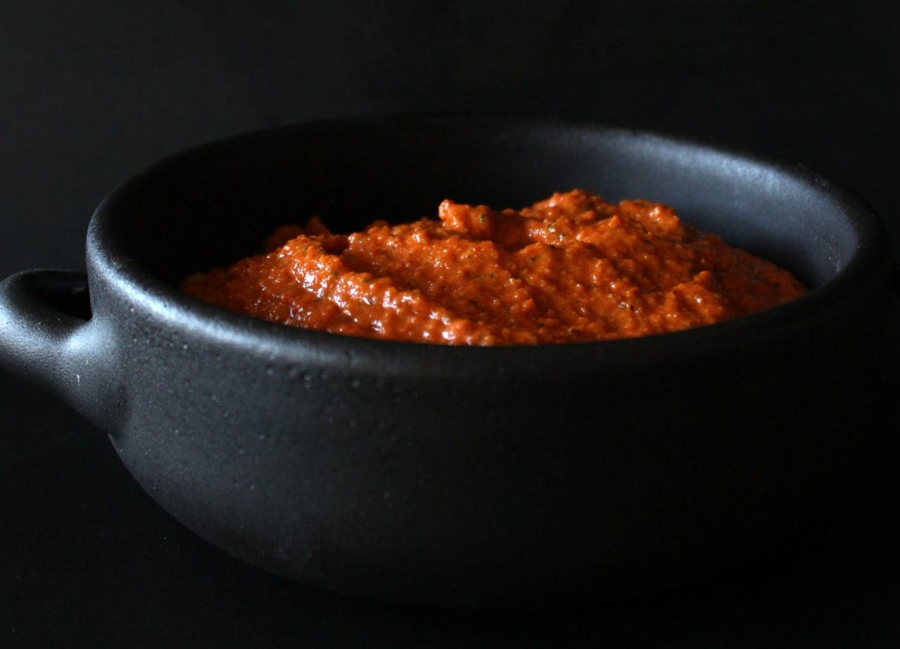 This dark and sassy Romesco Sauce is the beating heart of classic sauces. It's intense smoky flavour will have you licking your plate right until the end. #romesco #sauce #Spanish #SpanishSauce