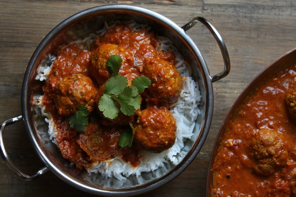 Rich and luxurious, here's a Butter Chicken recipe with a twist...it's in meatball form! Start with roasted spices and your mouth will thank you. #butterchicken #curry #meatballs #chickenmeatballs #garammasala #tandoorimasala #spices